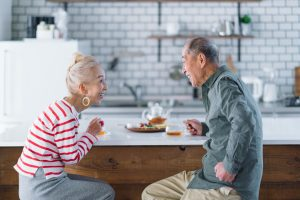 Senior couple having tea in kitchen