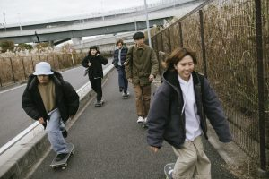 Young people skateboarding on city streets